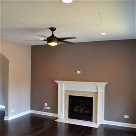 the color is sherwin williams sw6079 diverse beige and the place accent wall is
