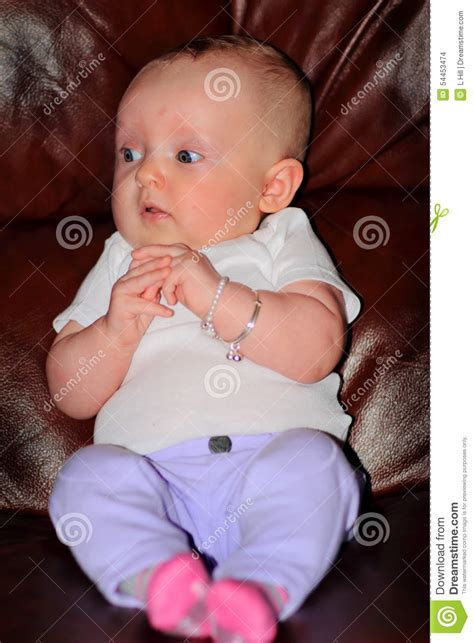 couch baby newborn on couch stock photo image 54453474
