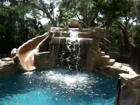 how to build a waterfall into a pool swimming pool with rock waterfall and slide youtube