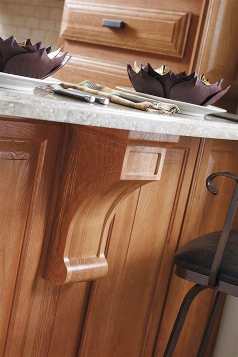 light oak cabinets with a black kitchen island masterbrand light oak cabinets with black kitchen island kemper