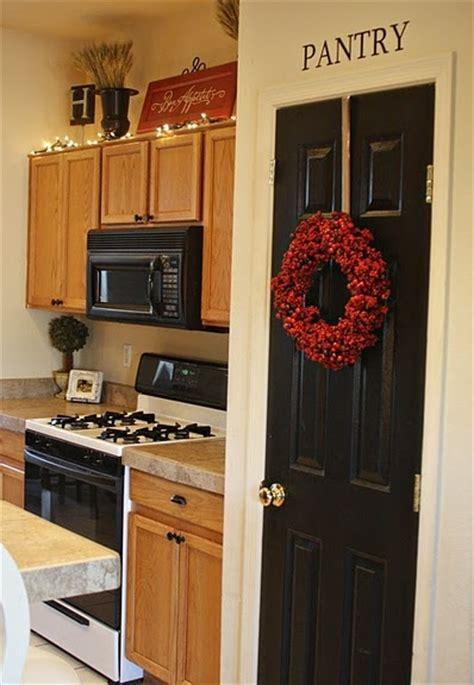 black doors plus wreath and pantry sign it all diy