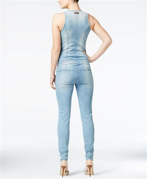 Via Guess Ripped Jacket Light Bahan lyst guess ripped denim zip up jumpsuit in blue