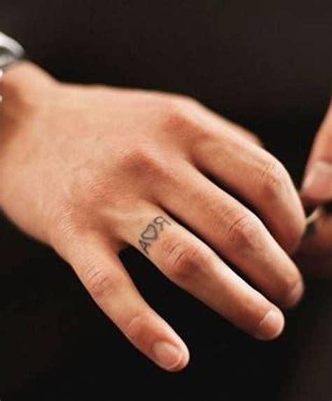 wedding ring tattoo removal faint wedding ring husband s initials