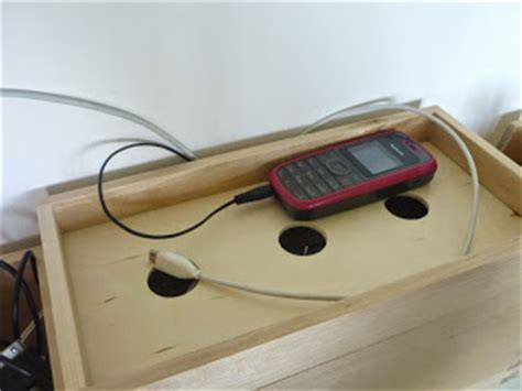 ikea hack charging station wall mounted charging station plus earphone cable storage