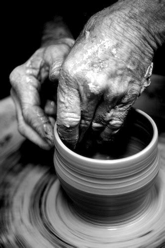 A potter's hands | Potter's wrinkled, clay covered hands