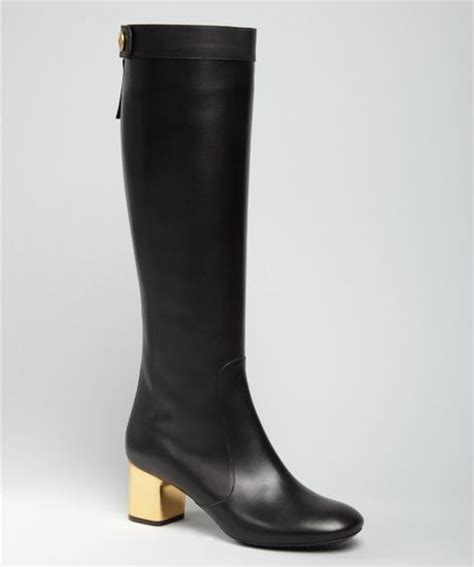 black leather gold heel boots in black lyst