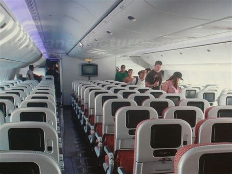Inside the VAustralia Plane. Lot's of head room but leg
