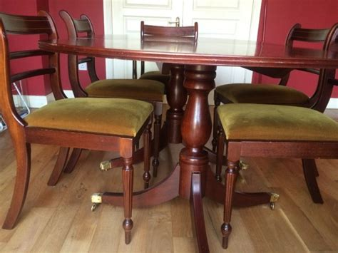 large oval mahogany double pedestal dining room table