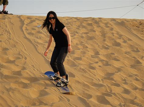 sand boarding dubai desert sand dune safari dubai