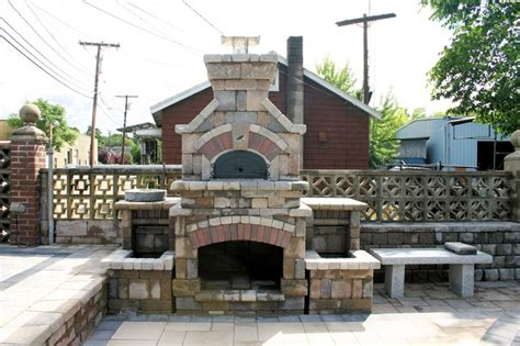Unilock Fireplace by Unilock Tuscany Fireplace With A Pizza Oven And