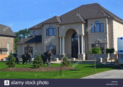 buying a big house a beautiful new big house from the front with the front yard and the stock photo
