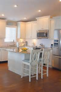 white and cream kitchen with eat butchera block island ideas design
