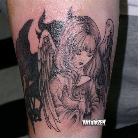 angel and demon fighting tattoos best tattos 2011 angel fighting devil tattoos