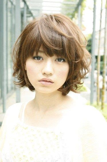 curly bob with shorter layers on top around face curly inverted bob with bangs layered bob with bangs