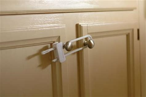 Your Baby S On The Move Baby Proofing Your House Baby Locks For Cabinet Doors