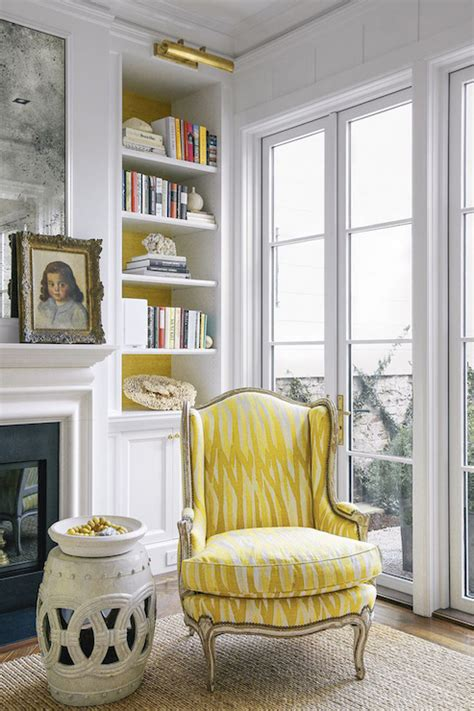 yellow wingback chair transitional living room