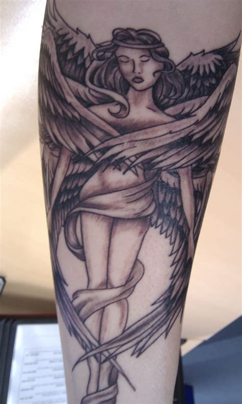 angel tattoo sleeve ideas for religious sleeve big