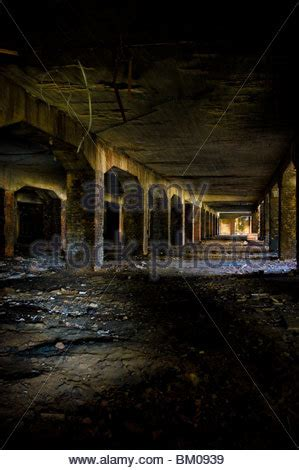 Empty Abandoned Bunker Interior With Dark End Of Grungy