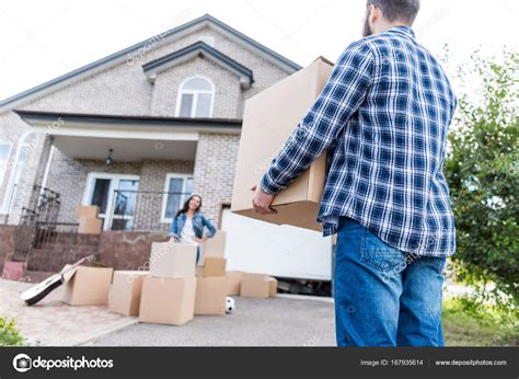 moving into a new house couple moving into new house stock photo 169 arturverkhovetskiy 167935614