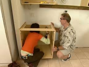 Installing Cabinets Kitchen How To Install Wall And Base Kitchen Cabinets How Tos Diy