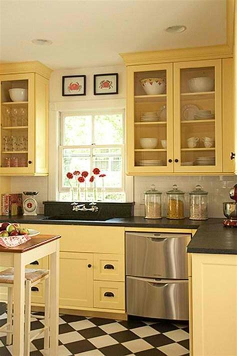 yellow kitchen with white cabinets drawers on sides of below sink better use of space love