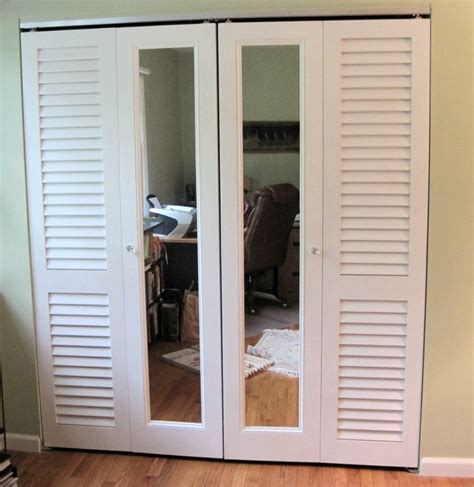 Shutter Doors For Closets A Combination Of Plantation Louvered Doors And Mirror Doors Are Used To Make Up These Bifold