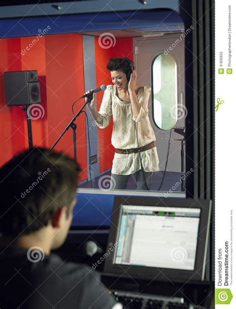 Studio Technician by Singing With Studio Technician In Foreground Royalty Free Stock Photo Image 31835655
