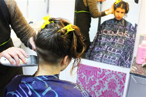 shave the women hair under pantes in salon undercut with nape shaved under very long hair and bangs