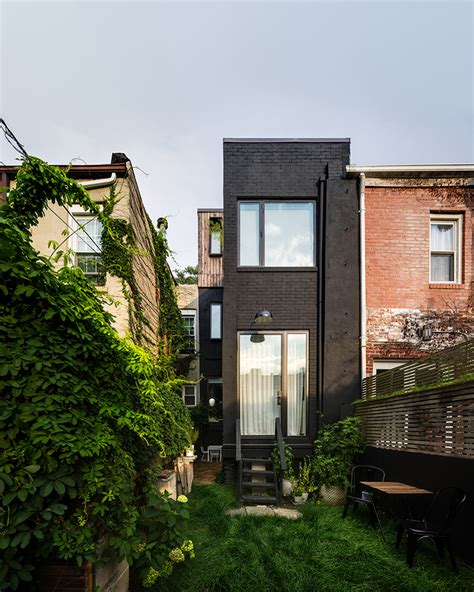 narrow row house office of architecture refurbishes narrow row house in