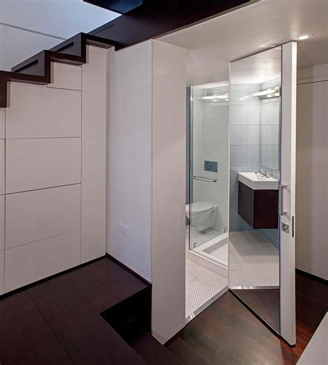 mirrored bathroom door manhattan micro loft apartment renovation by specht
