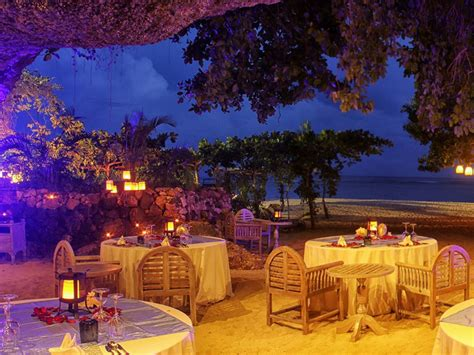 romantic beach cave dinner  samabe bali suites villas