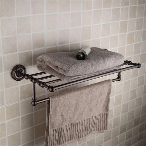 rubbed bronze brass 24 inch bathroom shelf with towel