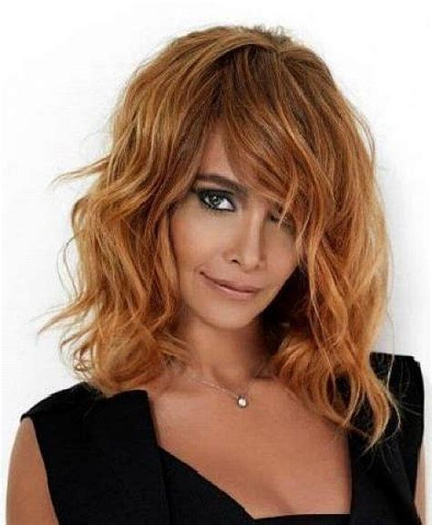layered beachy medium length haircut medium length layered hairstyles with side swept bangs for