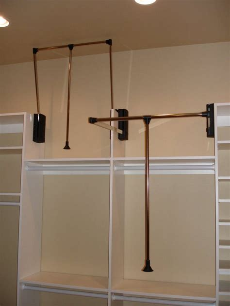 Laundry Room Shelf With Hanging Rod - create seasonal storage with a pull down closet rod of course this would involve raising my