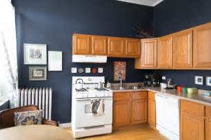 blue walls in kitchen this is how to deal with honey oak cabinets paint the walls midnight blue kitchen spotlight
