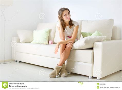 sitting on a sofa smiling girl sitting on sofa stock image image 28950601