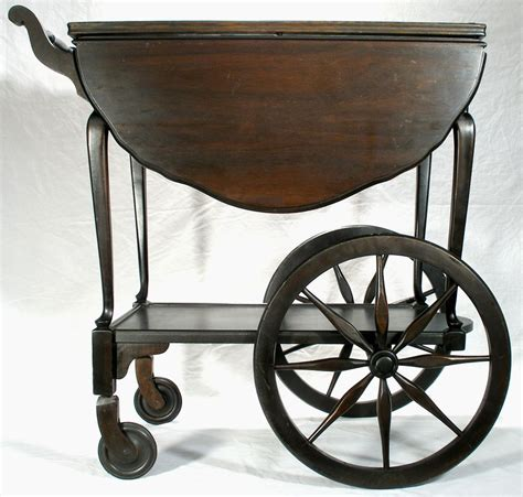 Vintage Mahogany Wagon Wheel Drop Leaf Tea Serving Cart Table from rubylane sold on Ruby Lane