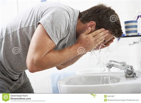 bathroom facial man washing face in bathroom sink stock photo image