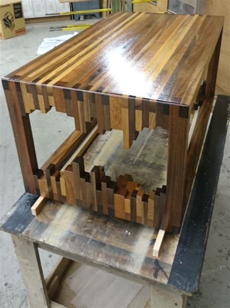 diy er creates  unique coffee table  stacking wood