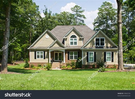 brick and vinyl siding house pictures upscale home brick vinyl shake siding stock photo 18565729 shutterstock