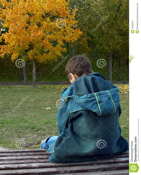 back bench boys lonely boy is sitting on a bench royalty free stock