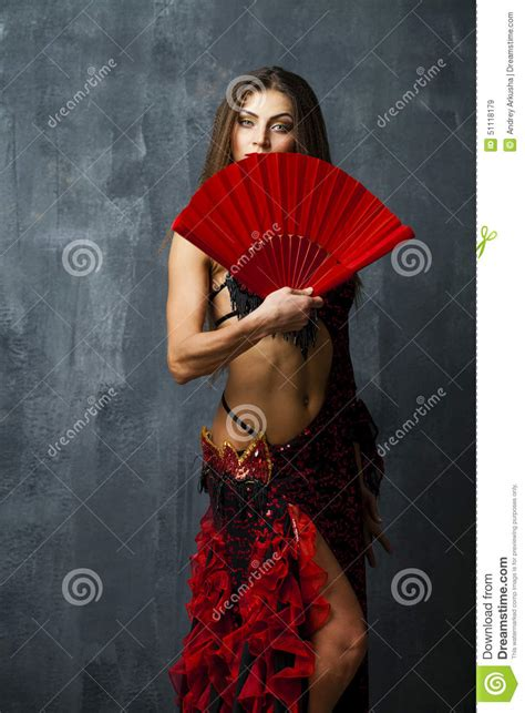 spanish dancer hairstyles woman traditional spanish flamenco dancer dancing in a red