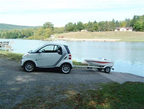 tow cer and boat smart car towing a tiny boat jorymon