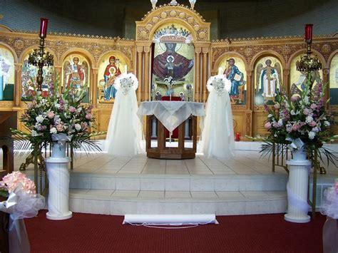 church wedding flowers   Altar view at the Assumption