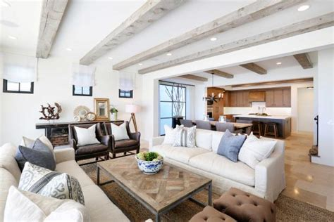 neutral beach home  exposed beams rustic elements