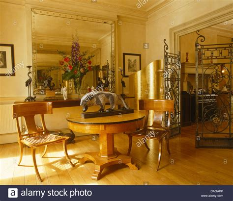 large dining room mirrors antique chairs and biedermeier table in dining room with