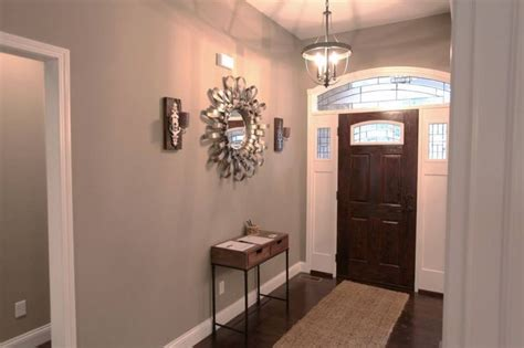 foyer with two toned fiberglass entry door paint color benjamin rockport gray mirror by