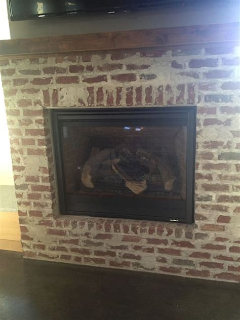 smeared mortar brick fireplace house
