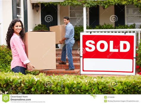 buying a house from a relocation company couple moving into new home royalty free stock image image 21156936