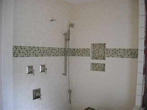 bathroom on pinterest mosaic tiles white subway tiles and glass tile accent w subway tile glass accent in built in